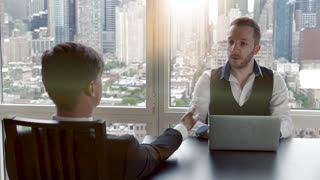 job interview business meeting of two young man in modern office. conversation