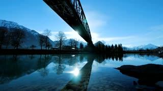 lake sea river pond. mirror water reflection. silhouette of bridge