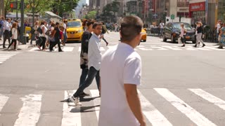 large group of people crossing crowded city street. new york scenery