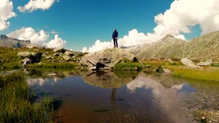 lifestyle background of young carefree man enjoying mountain nature landscape