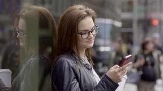 lifestyle portrait of beautiful confident women using smart phone. city people