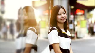 lifestyle portrait of young beautiful asian women. urban city background