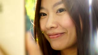 lifestyle portrait of young cute asian women looking at camera. city people view