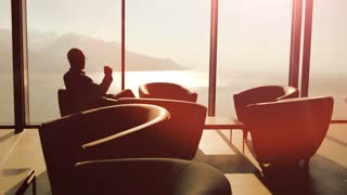 luxury glass interior. businessman sitting. modern lifestyle. man male. person