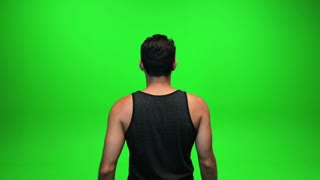 male holding hands up. isolated on green screen