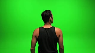 male looking around. isolated green screen