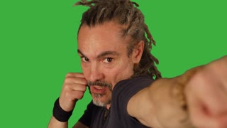 man boxing against camera isolated on green screen background