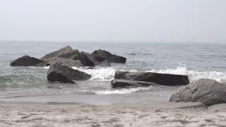 man jogging at the beach. slow motion. jogger