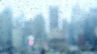 moddy wet weather background. raining city scenery. sad rain drops