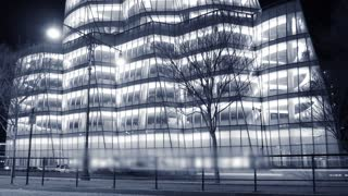 modern building architecture. urban night light scenery. time lapse of cars