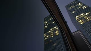 modern glass tower building. night lights. skyscraper skyline