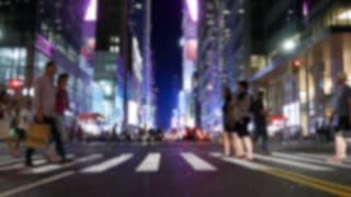 new york city scenery of people crossing street at night light