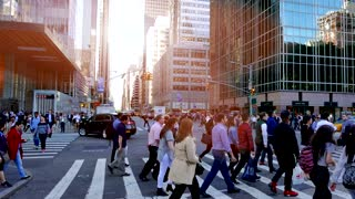 new york city street scene at sunset. crowd of people walking