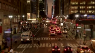 new york city street scene of people walking at night