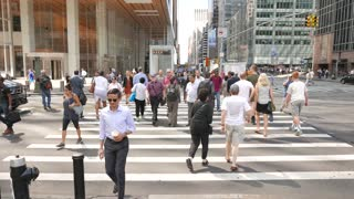 New York City streets scene. Crowd of business people commuting background