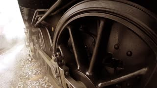 old historical steam engine locomotive train driving on railroad. nostalgic historical retro technology
