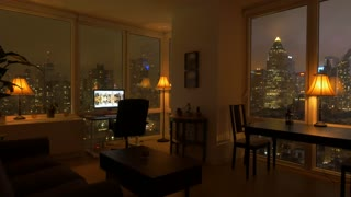 one person working at home in high rise city apartment loft at night