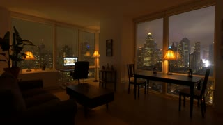 one person working at home in modern high rise city apartment loft at night