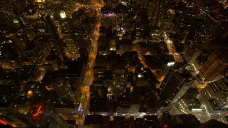 overlooking city at night. aerial view of cityscape. metropolis background