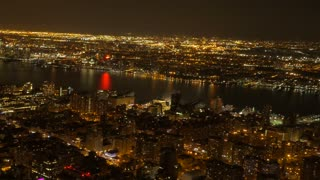 overlooking city metropolis at night. illuminated urban streets lights. new york