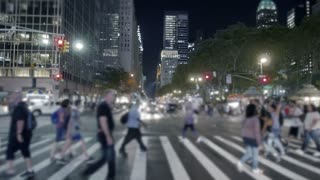 pedestrians walking in the city at night. new york street scene