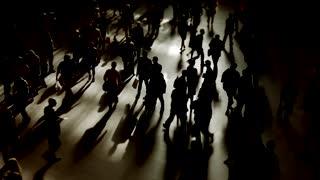 pedestrians walking on street in slow motion
