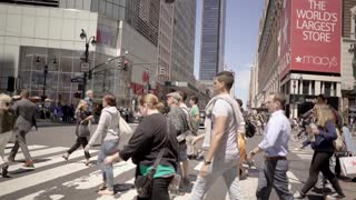 people commuting in new york city on crowded streets. urban lifestyle scene