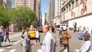 people crossing crowded street in the city