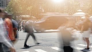 people walking on crowded street in the city. pedestrians commuters background