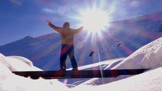 person raising hands up. snow winter season