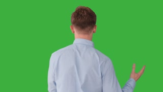 portrait of young caucasian man standing against green screen background