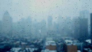 rainy day in the city. rain drops on window glass. depressive mood background