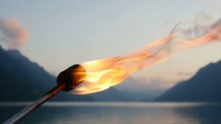 romantic fire torch light burning at twilight sky