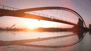 romantic sunset. bridge landscape. lake pond. slow motion