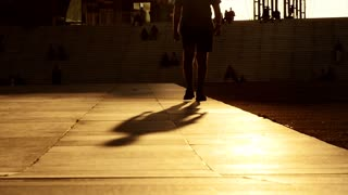 silhouette of male person walking. slow motion. sunset light