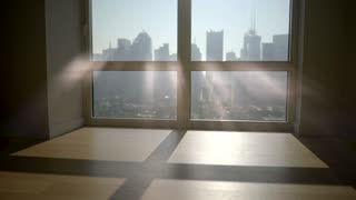 silhouette of man in the morning starting daily business in city office building