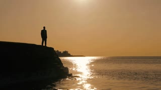 silhouette of man. person people. male. leisure activity. recreational. sunset