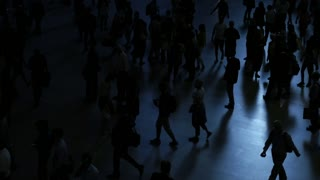 silhouette of people walking on crowded street. city commuters scene