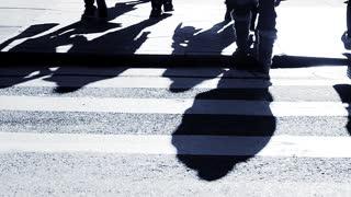 silhouette shadow of walking people. pedestrians walkers background