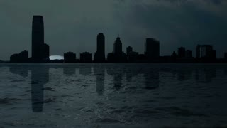skyline silhouette. moon. full moon. time lapse. water reflection. skyscrapers