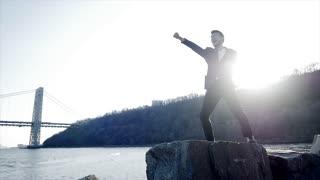 slow motion of man doing karate fighting training training outdoors