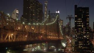 stunning hyper lapse shot of illuminated bridge road city panorama at night