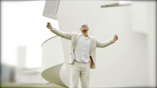successful young businessman in white casual suit jumping in slow motion