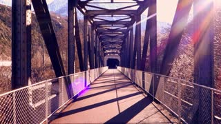 sun flare. lens flare. walking on bridge. colorful sun
