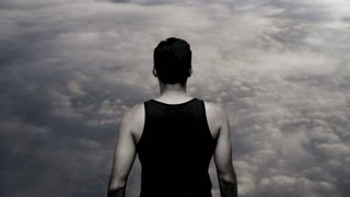 superhero powerful strong man male. on top. clouds. heaven. hands up