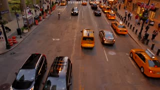 taxi cars commuting in new york city at night