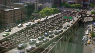 time lapse aerial shot of traffic commuting on city streets