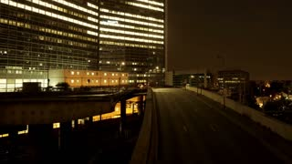 time lapse of city at night. traffic lights. modern buildings. urban background
