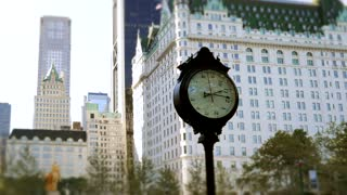 time lapse video of people rushing through the city. watch clock time background