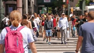 tourist walking through shopping district in new york city